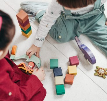 two-children-playing-with-lego-blocks-and-other-toys-3661450